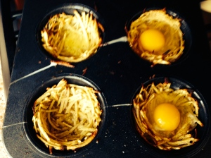Adding eggs to each nest and then bake for 8-12 minutes.